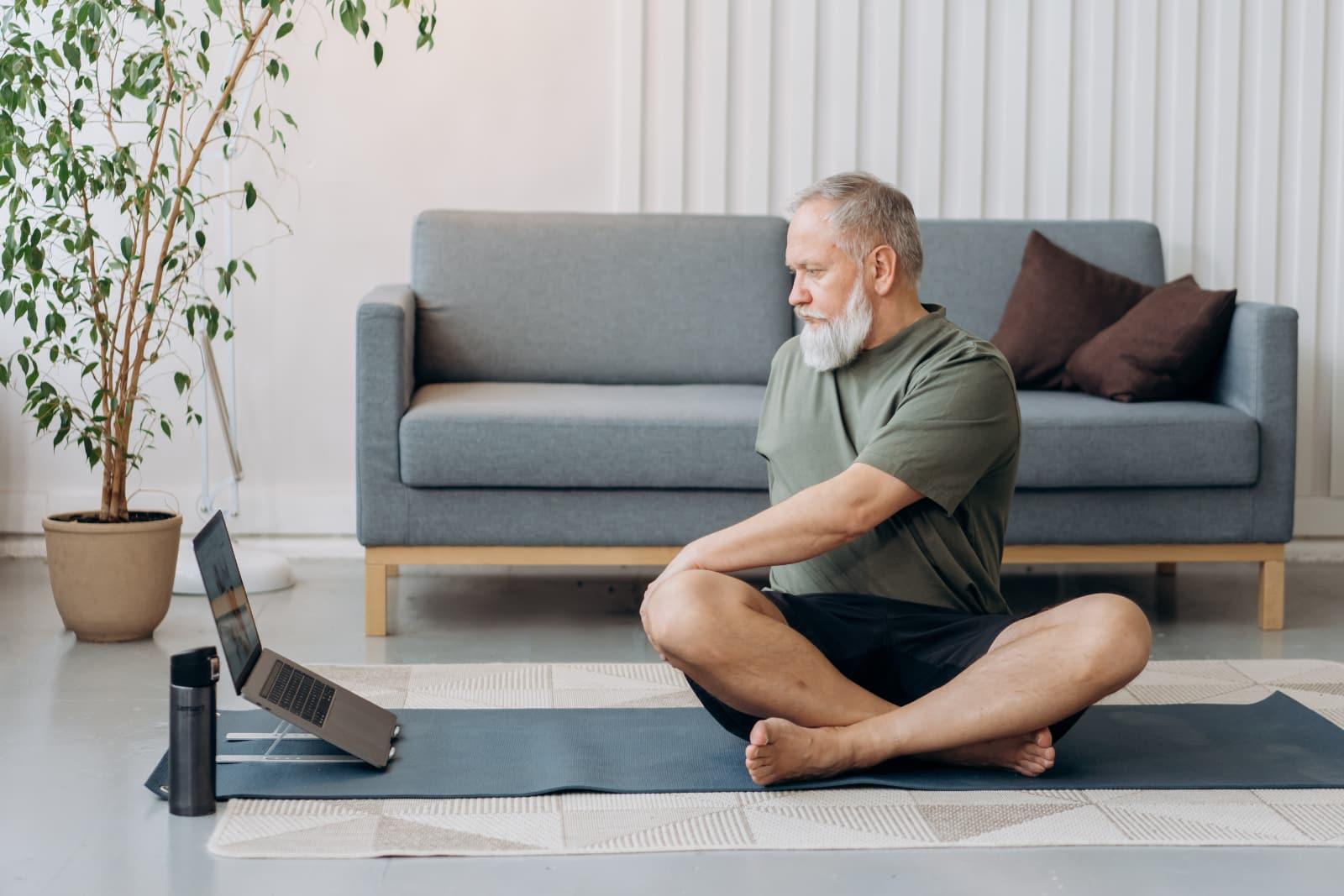 Man doing yoga on his living room floor